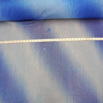 Faded blue on glue glitter